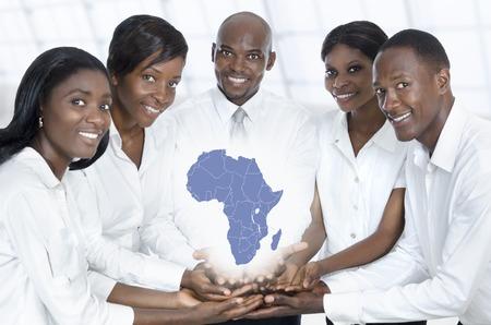 スタジオ撮影、アフリカの地図とアフリカのビジネス チーム 写真素材