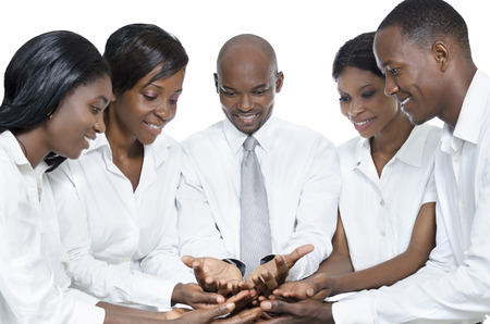 africa american: African business team presenting with open hands, Studio Shot Stock Photo