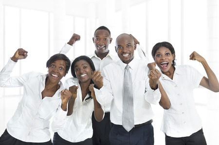 African business team cheering, Studio Shot Stock Photo