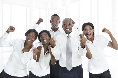 young cheering: African business team cheering, Studio Shot Stock Photo