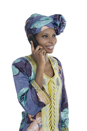 black empowerment: Traditional african woman talking with smart phone, Studio Shot