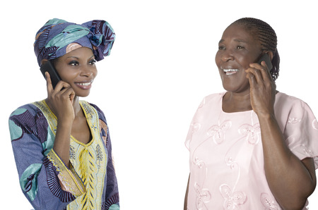 african village: African mother and daughter talking on smart phone, Studio Shot