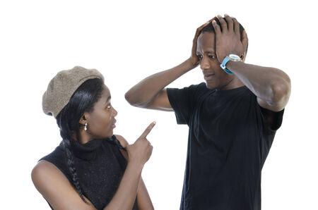 disharmony: Young african couple quarreling, Studio Shot