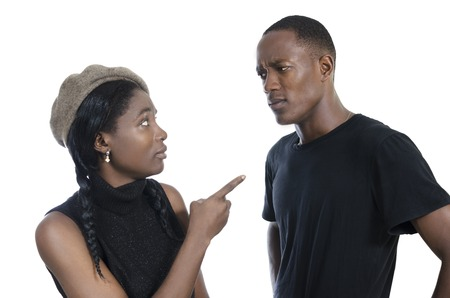 argument from love: Young african couple quarreling, Studio Shot