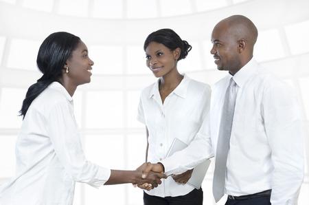 african american handshake: Three african business partners shake hands, Studio Shot