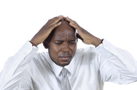 over worked: African business man has headache, Studio Shot Stock Photo