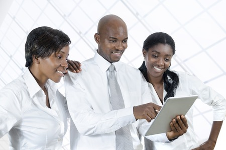 small group: Three african business people with tablet PC, Studio Shot