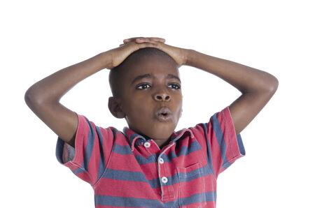 africa child: African boy in stress, Studio Shot Stock Photo
