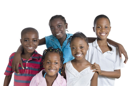 Five happy african kids holding one another, Studio Shot photo