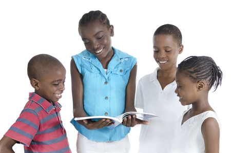 Four african kids learning together, Studio Shot photo