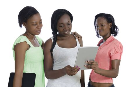 Three african women discussing with tablet PC, Studio Shot, Cameroon photo