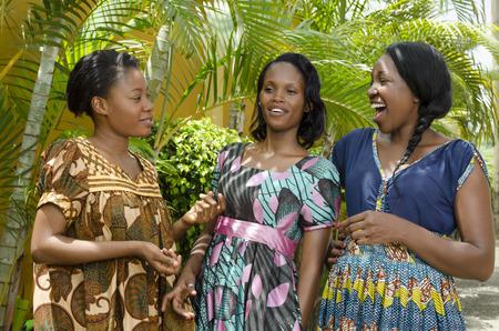 Three Happy African women Chatting Outdoor, Outdoor Shot Cameroon