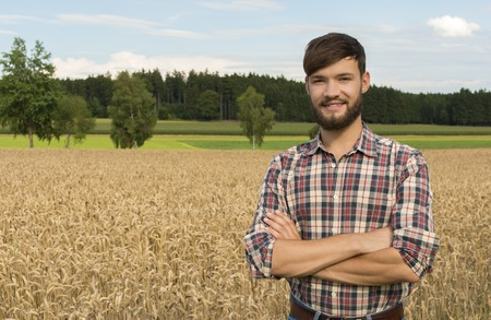 country life: Young farmer at the corn field, Outdoor Shot