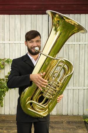 tuba: Male musician smiling with tuba, Outdoor Shot Stock Photo