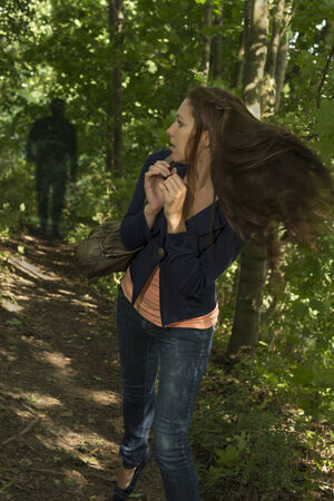 paranoid: Paranoid woman in fores, Outdoor Shot
