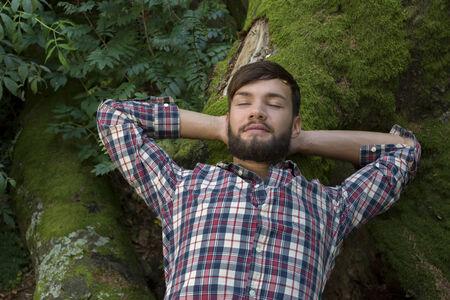 outdoor shot: Young man relaxing in nature, outdoor shot