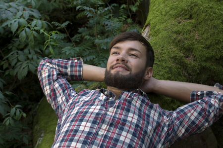 self worth: Young man relaxing in nature, outdoor shot