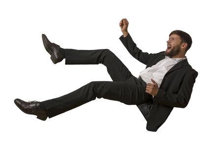 hombre cayendose: Caer aislado Hombre, tiro del estudio Foto de archivo