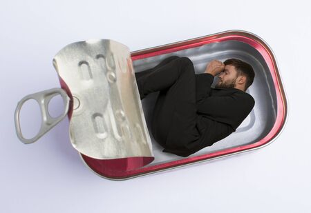 claustrophobia: Man in fish can Studio Shot montage Stock Photo
