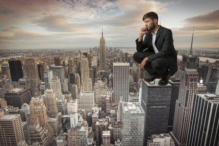 arrogant: Man sitting on Skyscraper Studio Shot Montage Stock Photo