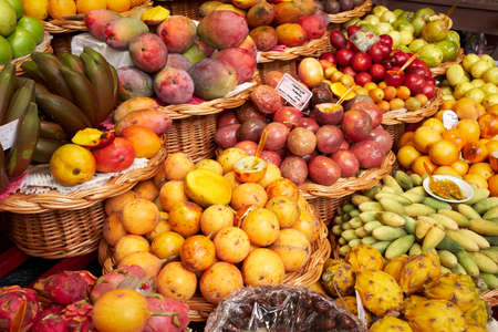Fresh exotic fruits in Mercado Dos Lavradores traditional market. Funchal, Madeira island, Portugal