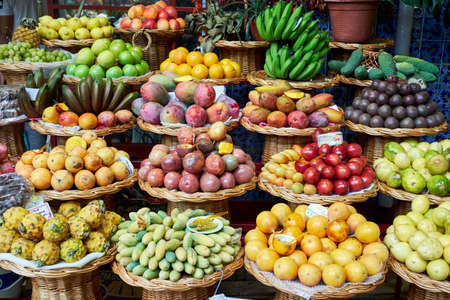 Fresh exotic fruits in Mercado Dos Lavradores traditional market. Funchal, Madeira island, Portugal
