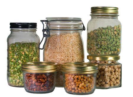 dried vegetables: Diversas legumbres secas almacenadas en tarros de vidrio para el invierno.