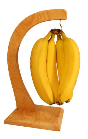 potassium: Bright yellow bananas hanging from a wooden banana stand. Bananas, genus Musa, are a delicious source of Vitamins A, B6, and C and of potassium.
