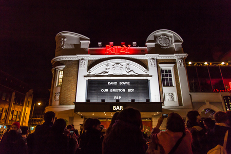 brixton: LONDON, UK - JANUARY 11TH 2016: Fans paying tribute to David Bowie at The Ritzy, Brixton. One day after his death, They Gathered to a street party to celebrate his life.