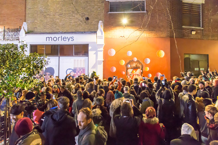 brixton: LONDON, UK - JANUARY 11TH 2016: Fans paying tribute to David Bowie at Brixton. One day after his death, They Gathered to a street party to celebrate his life.