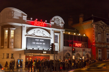 LONDON, UK - JANUARY 11TH 2016: Fans paying tribute to David Bowie at The Ritzy, Brixton. One day after his death, They Gathered to a street party to celebrate his life.