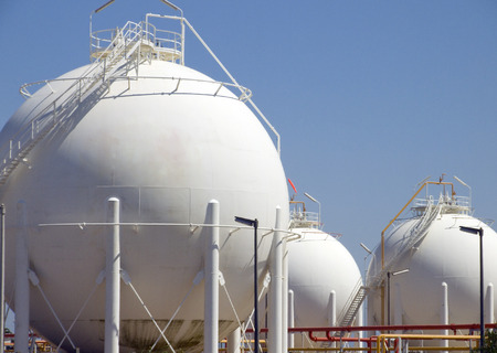 Detail from very big round containers of fuel Stock Photo