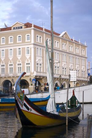 bilding: Tipical moliceiro boat in Aveiro city on the sunset - Portugal