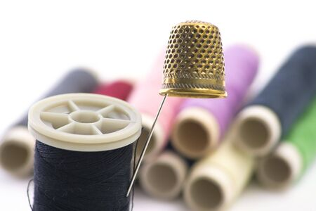 Sewing Supplies with threads on background  photo