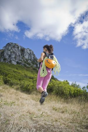 Young adult woman treking in the mountains photo