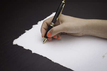 Woman about to write on a recycle black paper photo
