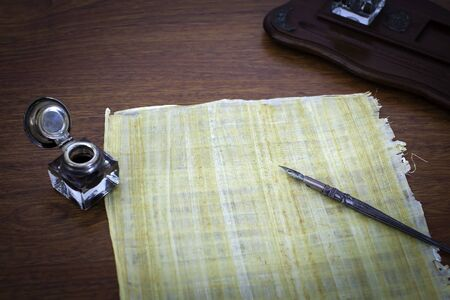Old papyruns on a desk with ink and pen Stock Photo - 9502189