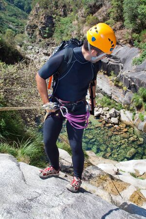 rappeling: Men prepering to rappeling on waterfall
