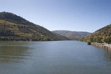 View from the Douro river to Pinhão vilage in Portugal photo