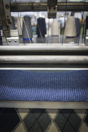 Textile machine weaving a sweter