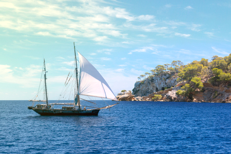 Sail boat arrive to island