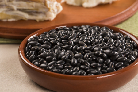 turtle bean: Black beans on wooden background Stock Photo