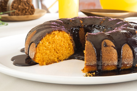carrot cakes: Carrot cake with chocolate and slice on the table.