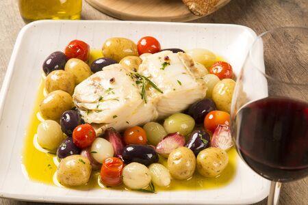 original plate: A typical Portuguese dish with codfish called Bacalhau do Porto in a original portuguese plate. Stock Photo