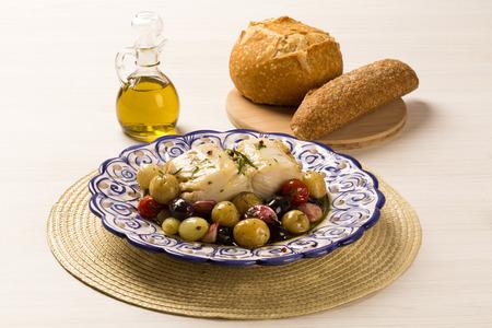 uvas: A typical Portuguese dish with codfish called Bacalhau do Porto in a original portuguese plate. Cod Fish Prepared. Foto de archivo