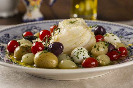 onion: A typical Portuguese dish with codfish called Bacalhau do Porto in a original portuguese plate. Cod Fish Prepared. Foto de archivo