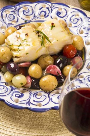 original plate: A typical Portuguese dish with codfish called Bacalhau do Porto in a original portuguese plate. Cod Fish Prepared. Stock Photo