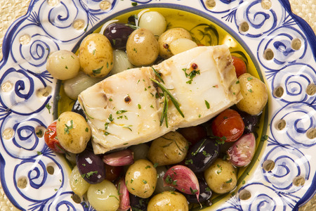 A typical Portuguese dish with codfish called Bacalhau do Porto in a original portuguese plate. Cod Fish Prepared. Stock Photo