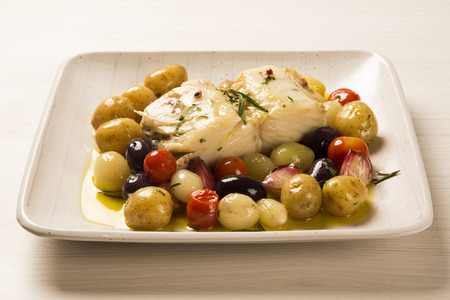 codfish: A typical Portuguese dish with codfish called Bacalhau do Porto in a original portuguese plate. Stock Photo