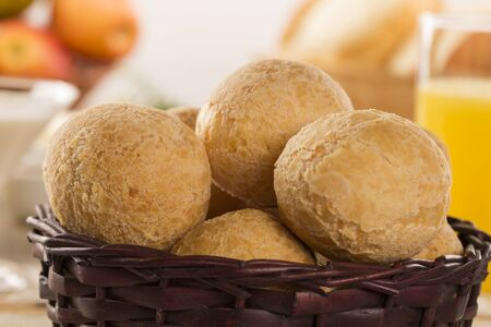 cheese bread: Brazilian cheese buns . Table cafe in the morning with cheese bread and fruits.